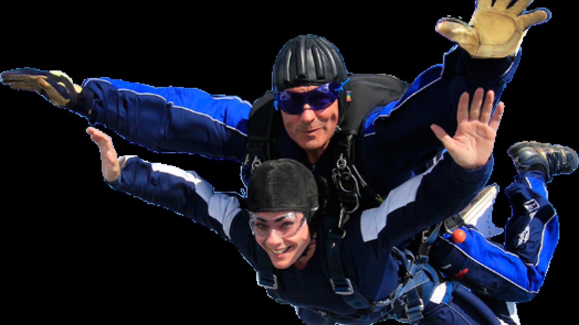 Folk som hopper i fallskjerm