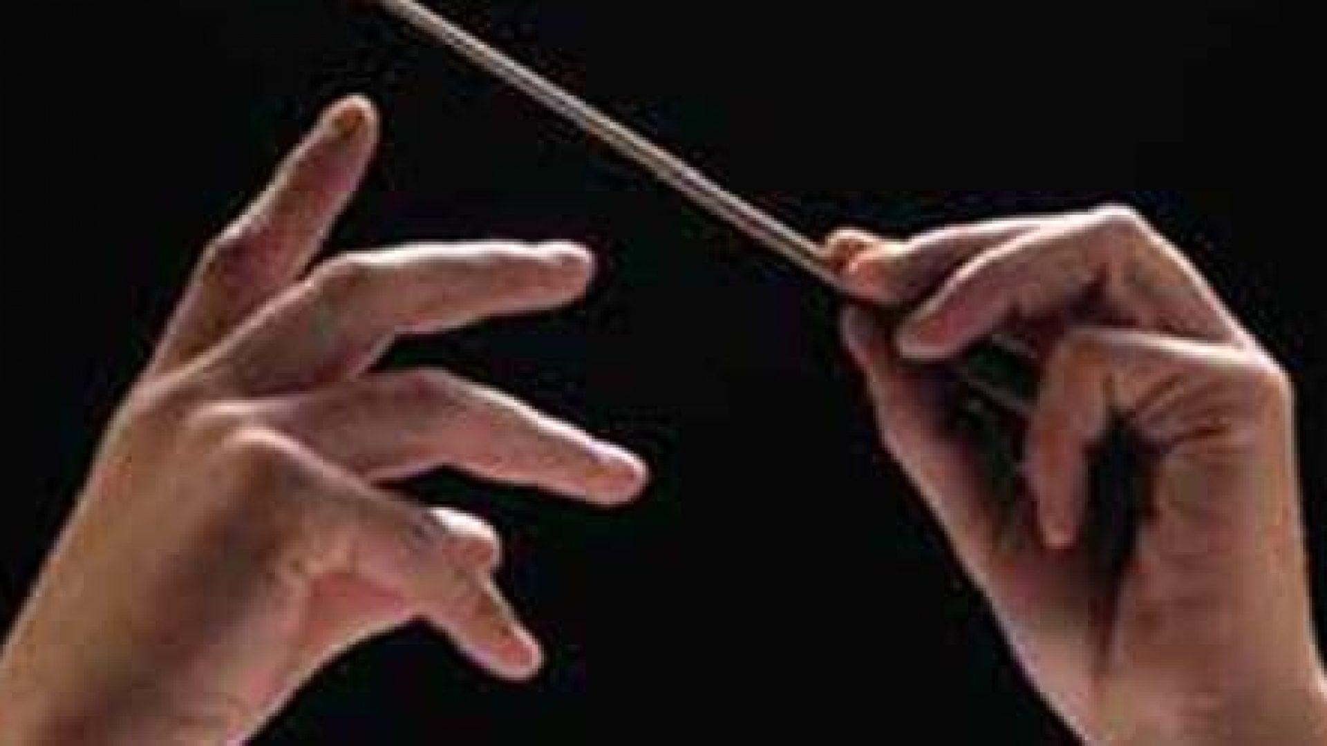 Dirigent-stokk og hender