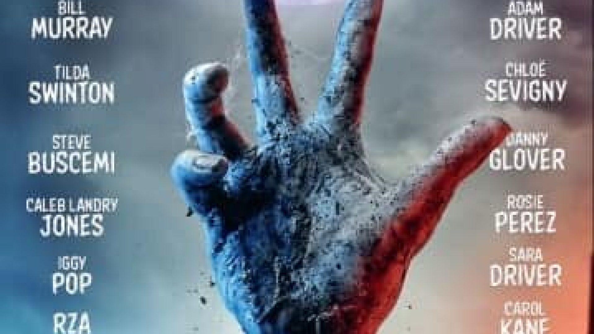 Zombiehand som kommer opp av jorda